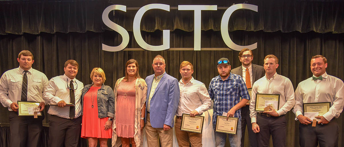 "Shown above (l to r) are the first recipients of the Adrian ""Goose"" Johnson CAT Thompson Tractor Tool scholarships: Tyler Singletary, Ethan Wendell, Goose's family Amber Johnson, Sarah Johnson and Kelly Johnson, Logan Crutchfield, Noah Schrum, Ben Selman, Cole Holland, and Justin Greenhaw."