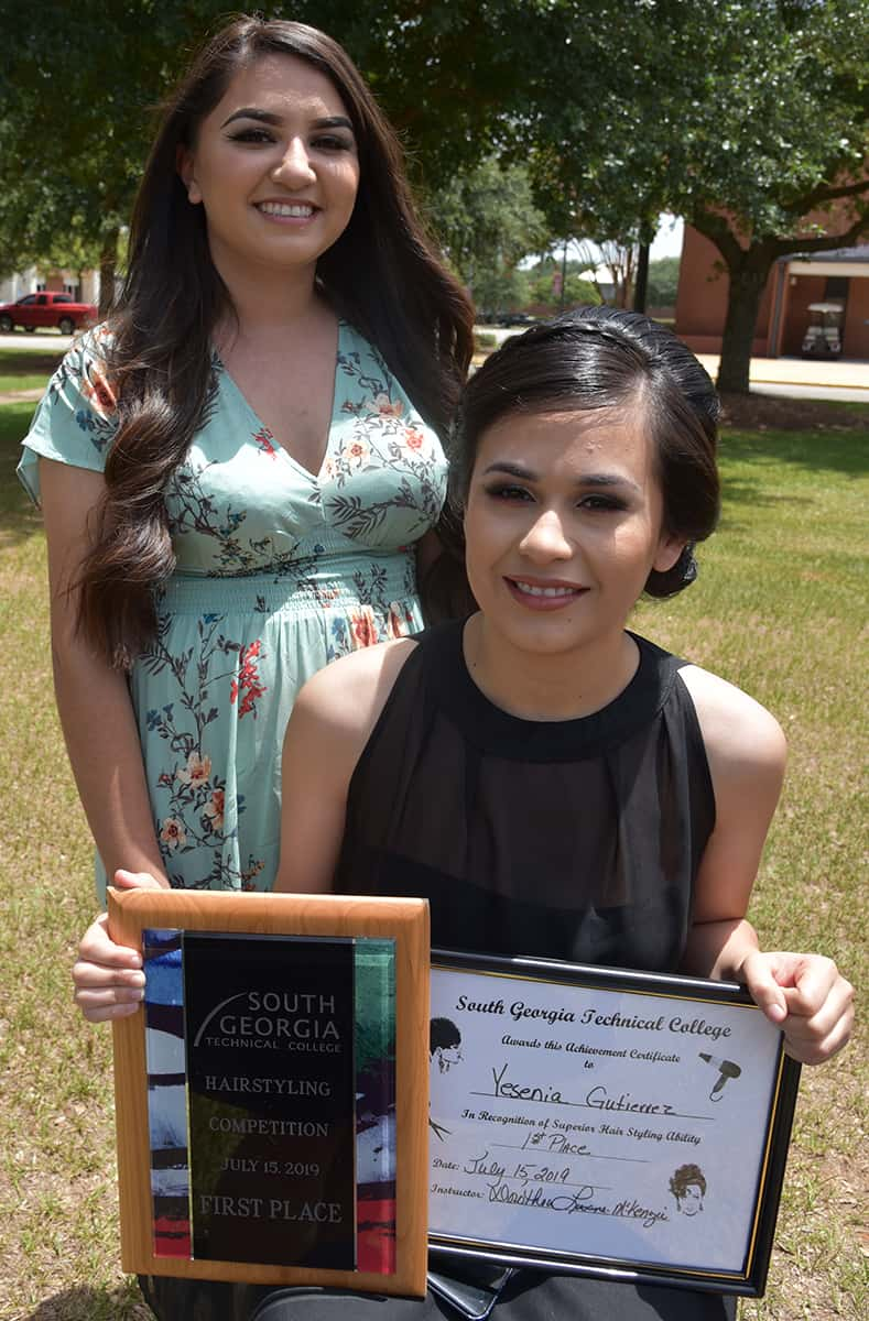 Yeshia Gutierrez of Oglethorpe took first place in the South Georgia Technical College Cosmetology hairstyling competition recently.  She is shown here with her model Paola Gutierez.