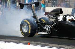 Race Car burning rubber smoking tires