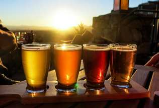 Colorful beer flight on a wooden table