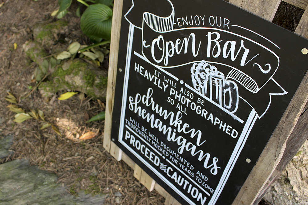 Hand lettered pallet chalkboard open bar sign for rustic country wedding by South Ranch Creative. Photograph by Summer Kelley Photography.