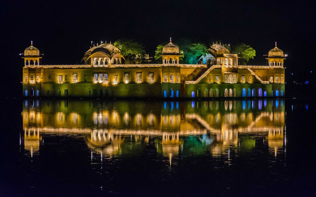 First sight of the Jal Mahal, literally 'Fort of the water' on the Amber Fort road in Jaipur.