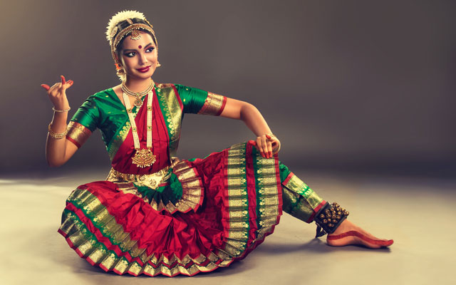 Beautiful Indian girl dancer performing a Indian classical dance form called Bharatanatyam .