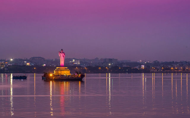 Evening picture of the monolithic statue of Gautam Buddha stands in the middle of the lake Hussain Sagar in Hyderabad, India.