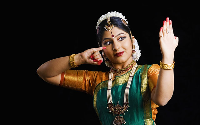 Close-up of a young woman performing Bharatnatyam