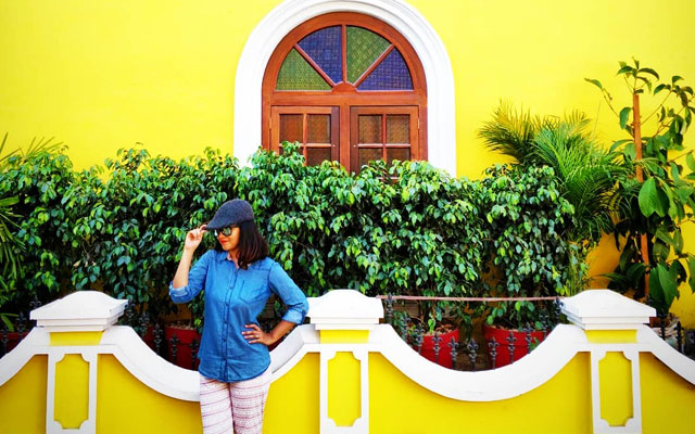 A young women posing for a photo in Fort Kochi