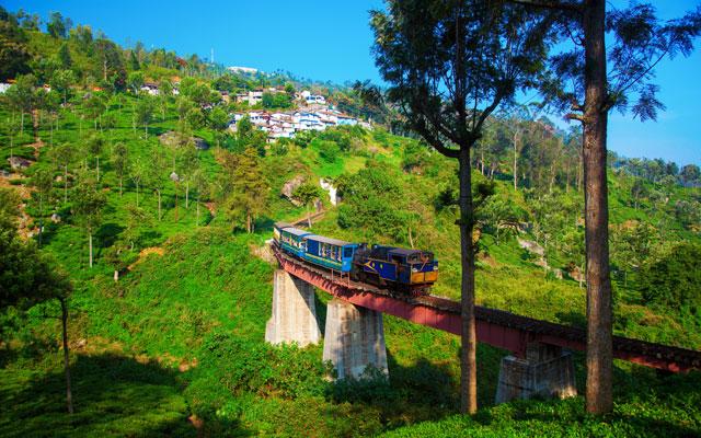 Old steam engine train populary called as Nilgiri Heritage Mountain Train in Nilgiri mountains, India.