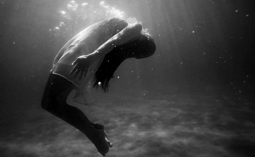 girl floating underwater