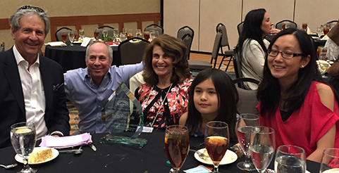Suzi Resnik celebrates with members of her family at the 2017 SOHA Awards Luncheon.