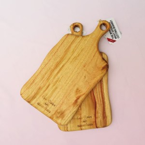 Two medium wooden paddle boards