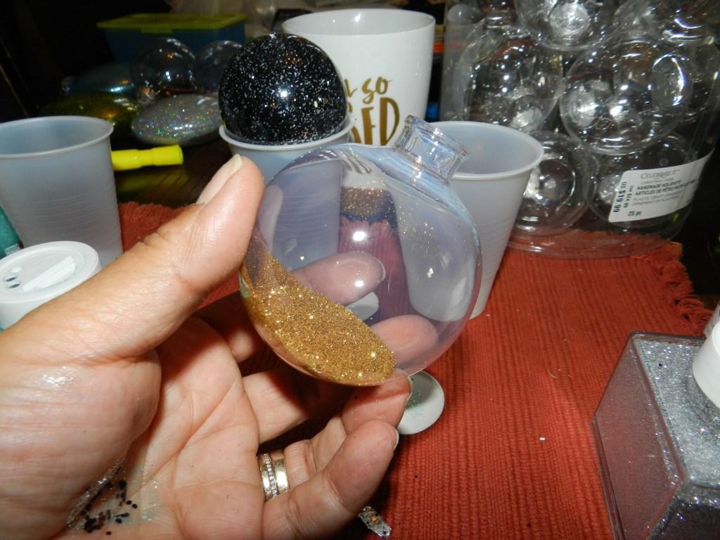 Add glitter inside ornament