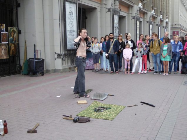 Crazy russian guy burning himself, eating fire, walking on glass and doing other charming activities of that type!