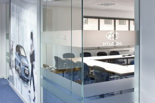 Image of Hyundai Training Centre glass office walls detail with opaque vinyl signage