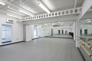 Image of Laine Theatre Arts dance studio retractable full-height doors - fully open