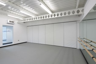 Image of Laine Theatre Arts dance studio retractable full-height doors - closed