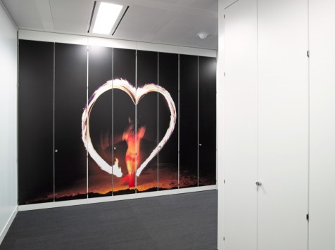 Image of Thomas Cook HQ office storage wall with digital graphics applied to doors