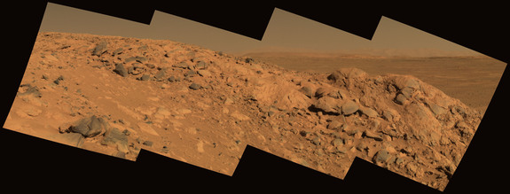 """Columbia Hills is another of NASA's top three choices for landing the upcoming Mars 2020 rover. This photograph was taken by NASA's Spirit rover; Gusev crater can be seen on the horizon behind a rock outcrop called """"Longhorn."""""""