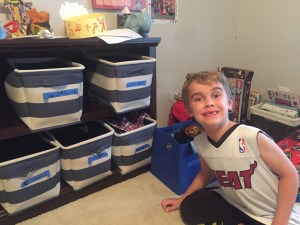 Organizing With Kids - Space and Serenity - Kid With Bins