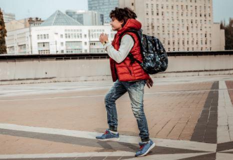 Boy Running to School