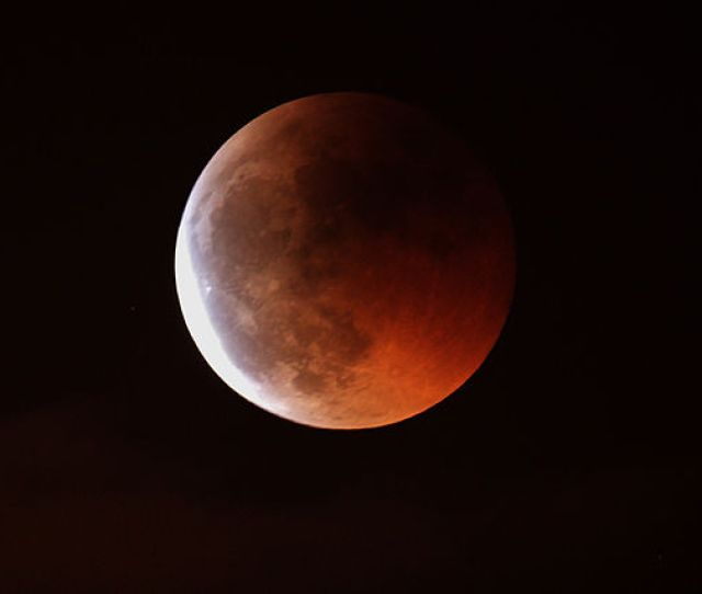 During A Total Lunar Eclipse Light Is Bent And Filtered As It Passes Through The