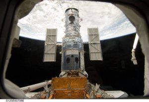 The Hubble Space Telescope stands tall in the cargo bay of the space shuttle Atlantis following its capture on Wednesday, May 13, 2009. The STS-125 mission began a series of spacewalks the following day to service Hubble. Image: NASA