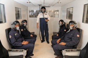 Companies like NASTAR aim to provide standardized training for suborbital spaceflight participants, but the curricula are anything but standardized. Pictured here, a NASTAR class in the altitude chamber (Credits: NASTAR Center).