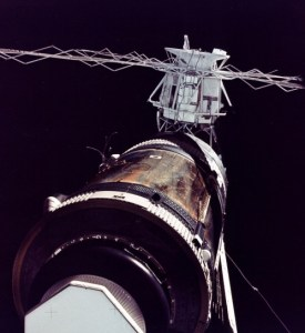 "Skylab's precarious condition is evident in this image from Pete Conrad's crew, revealing the tubing and wiring from the torn solar array at middle left. For several days, power came from the ""windmill"" of arrays on the Apollo Telescope Mount (background) (Credits: NASA)."