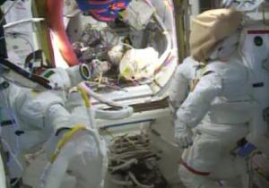 Spacesuits lay idle until a leak in Parmitano's suit, pictured left, can be found and resolved (Credits: NASA).