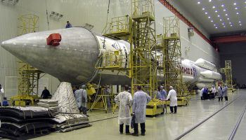 Assembly of a Proton rocket. – Credits: Pavel Kolotilov, Wikimedia