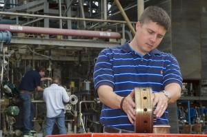 An engineer inspects the injector (Credits: NASA).