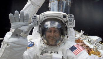 Mission Specialist Mike Massimino on EVA in 2002 to replace the Hubble's port solar array (Credits: NASA).