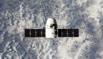 Dragon in orbit during its CRS-2 mission (Credits: SpaceX).