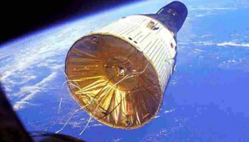 Gemini VII, bearing astronauts Frank Borman and Jim Lovell on a record-breaking 14-day mission, is seen through the windows of Gemini VI-A, with fellow spacefarers Wally Schirra and Tom Stafford. This mission, in December 1965, marked the first 'true' rendezvous between two piloted vehicles in orbit (Credits: NASA).