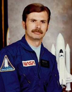 Dale Gardner in his official NASA portrait (Credits: NASA).