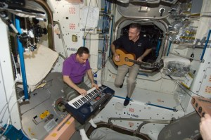 Astronaut Dan Burbank and cosmonaut Anton Shkaplerov make music on ISS in 2012 (Credits: NASA).