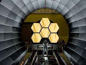NASA engineer Ernie Wright looks on as the first six flight ready James Webb Space Telescope's primary mirror segments are prepped to begin final cryogenic testing at NASA's Marshall Space Flight Center (Credits: NASA/MSFC/David Higginbotham).