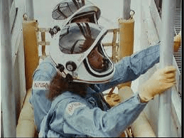 STS-41D astronaut Judy Resnik rehearses procedures for operating the slidewire baskets on Pad 39A. Such procedures would be followed in the event of an evacuation from the orbiter (Credits: NASA).