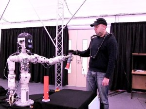 Chris practices handing off an object to BERT-2 (Credits: Bristol Robotics Laboratory).