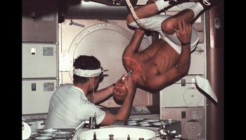Skylab 1 commander Pete Conrad undergoes a dental examination by medical officer Joseph Kerwin