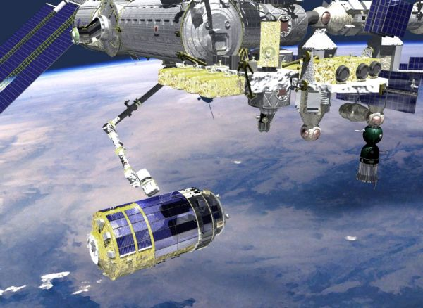 JAXA's HTV being captured by ISS robotic arm for berthing. Credits: ESA