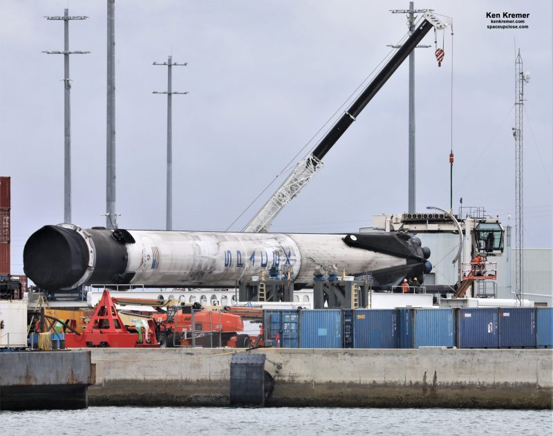 Falcon 9 Booster from 1st Human Launch Lowered and Transported to Cape, Fate TBD: Photos