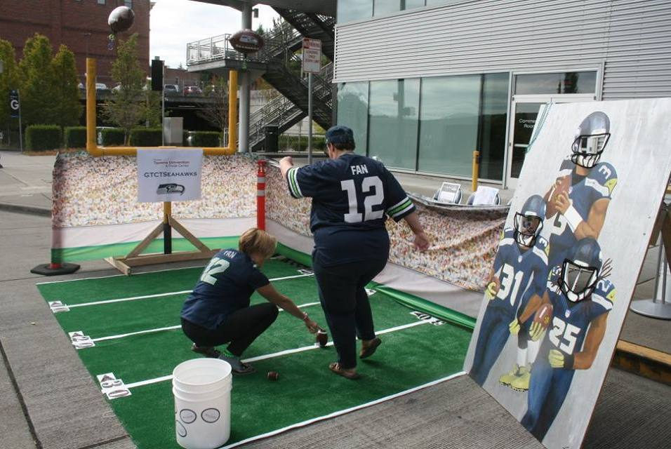 Greater Tacoma Convention & Trade Center set up a miniature football for parking PARK(ing) Day 2015
