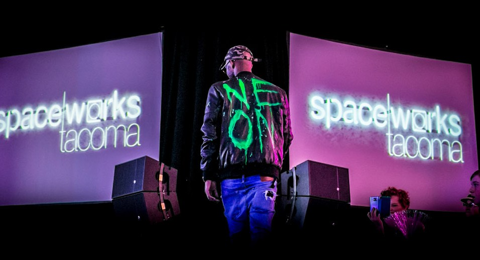 'Neon' Dion Thomas exits stage after giving a keynote speech on the runway at NEON 2016. Photo by Scott Haydon.