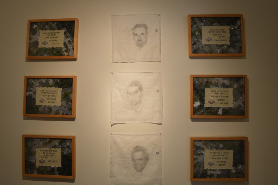 "Works by Tatiana Garmendia: Middle Row: Dr. Jose Manuel Garmendia Sr., Abuelo, Dr. Jose Manuel Garmendia Jr., Papi & Dr. Jose Manuel Garmendia Sr., Hermano, 16"" x 16"", graphite on distressed cotton handkerchief, 2017. Outer Rows: In A Green and Peaceful Neighborhood (six panels), 2017, 13"" x 17"" each, embroidered doilies on aerial photographs. Serving as surrogates for the domestic domain, each of the embroidered doilies testifies to the brutal disruption the artist's family suffered when the father was forcibly removed by authorities. Mounted on aerial drone photographs of local suburban neighborhoods, they signal it can happen anywhere, anytime. Geographical differences and generational distance between persecuted groups vanish in light of human suffering."