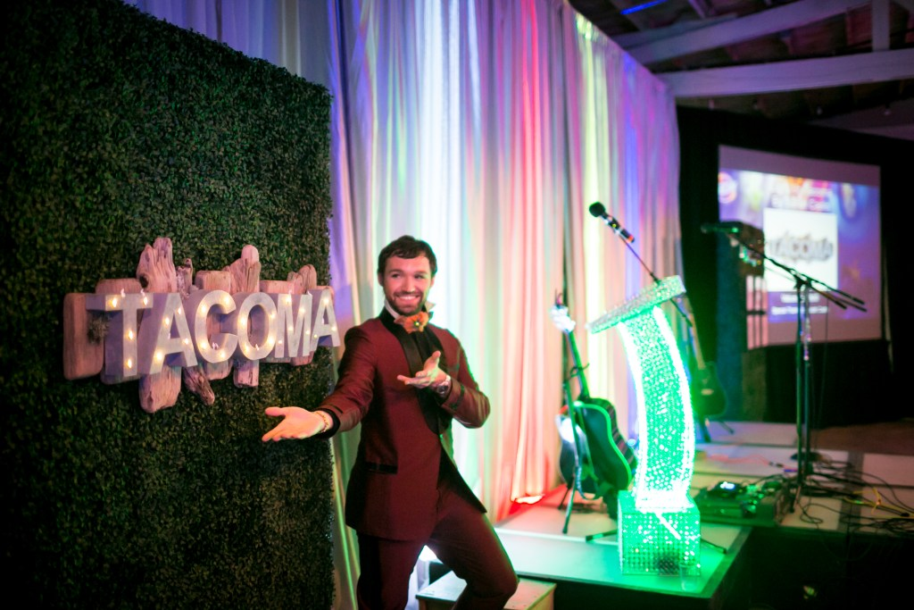 Dmitry Mikheyev co-hosting Live Auction at Spaceworks NEON 2017 in his character as Mylo Precious. Photo by Scott Haydon.