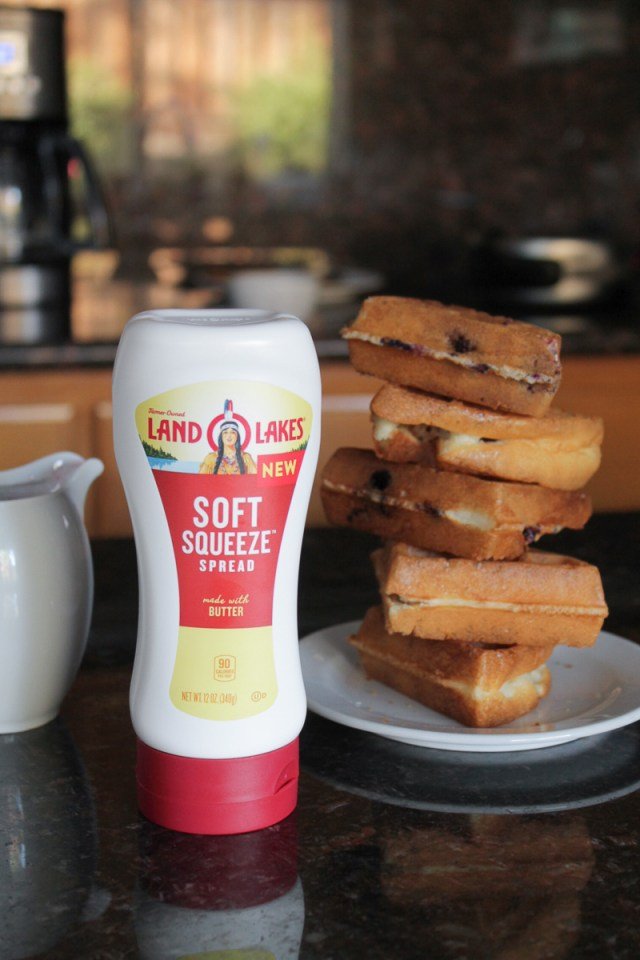 A stack of waffles next to Land O Lakes Soft Squeeze™ Spread