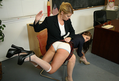 The naughty lady gets spanked on her white school panties for breaking the rules