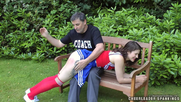 Naughty cheerleader Katie Brown gets spanked OTK by the coach, John Osborne