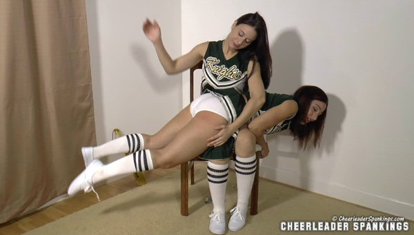 Sarah spanks cheerleader Jordana Leigh OTK over her white panties