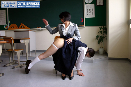 Cute asian babe gets beautifully spanked by her sexy teacher